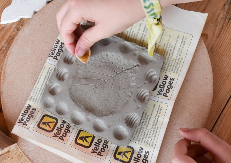 kids activities at Timber Festival - clay tiles