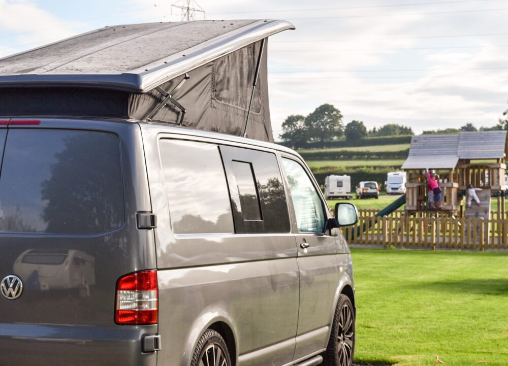 VW T5 camper with kids and pop top roof